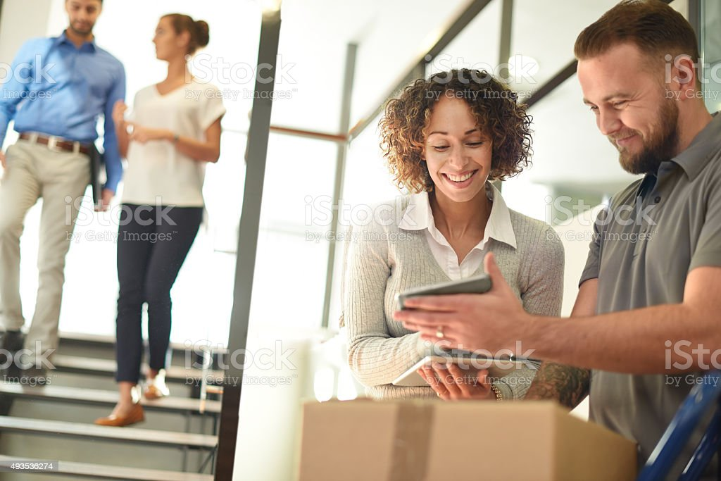 parcel delivery at office stock photo