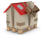 Parcel in the form of home wrapped in ribbon.