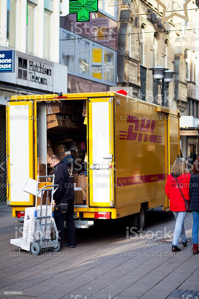 Parcel service of DHL stock photo