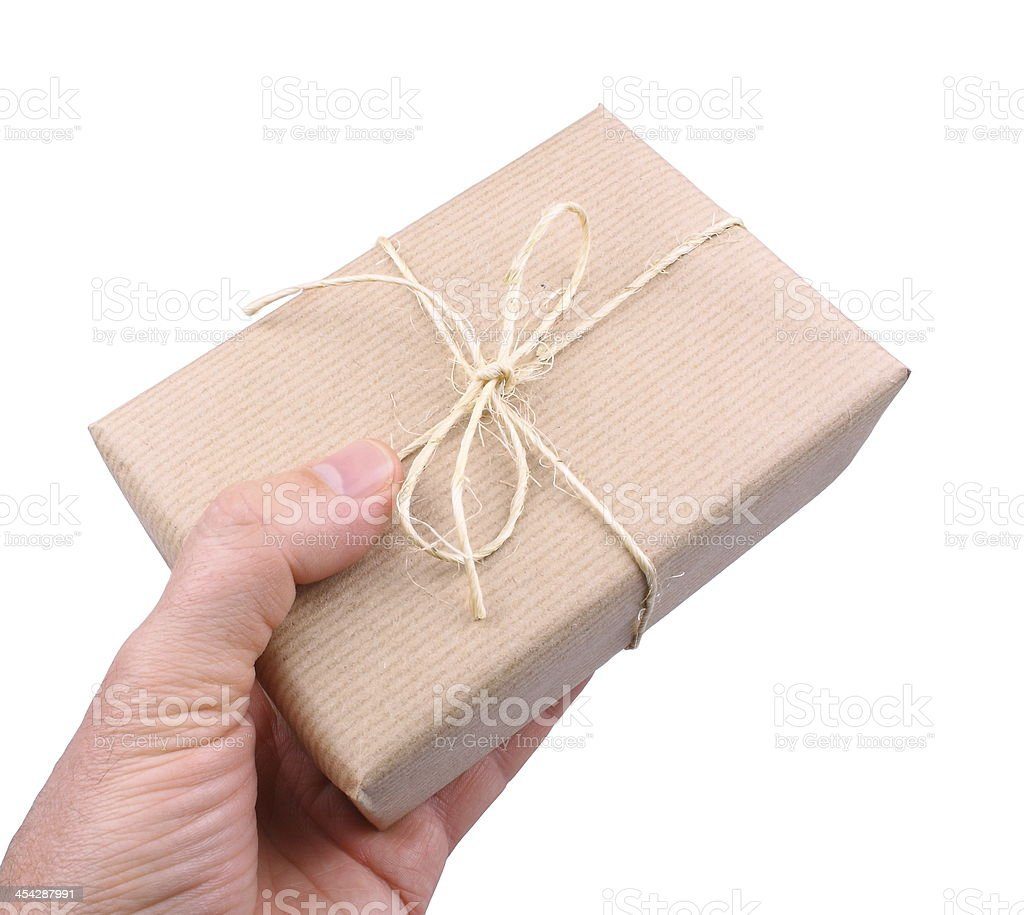 Parcel wrapped in brown paper man's hand isolated royalty-free stock photo