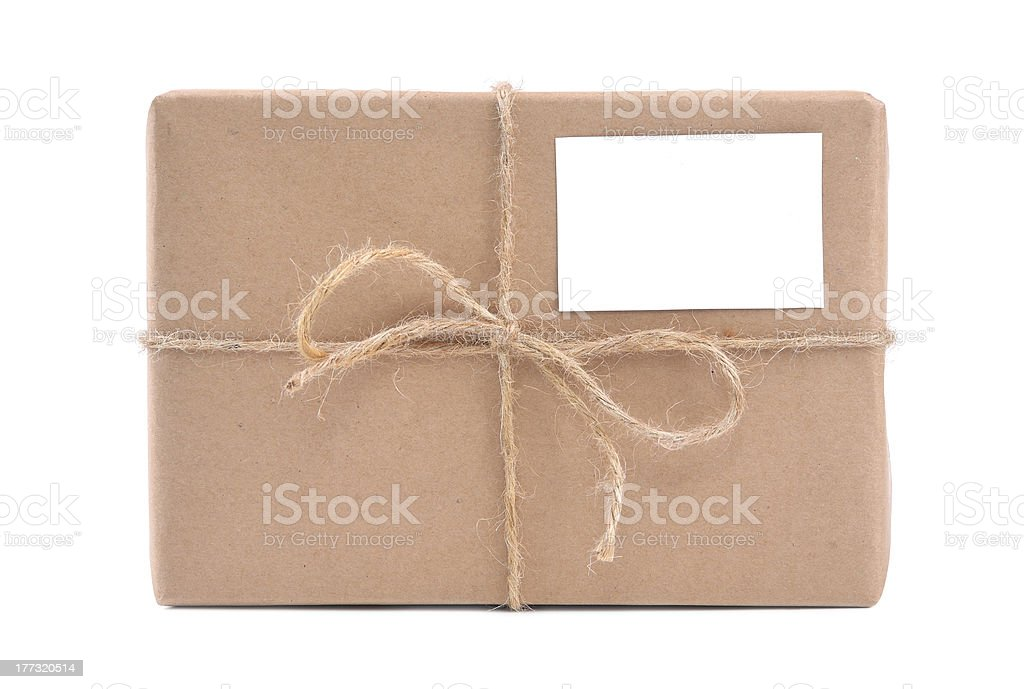 Parcel wrapped in brown paper royalty-free stock photo