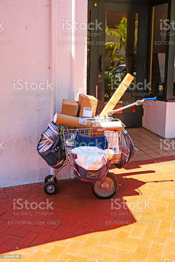 Parcels and letters in a USPS delivery cart stock photo