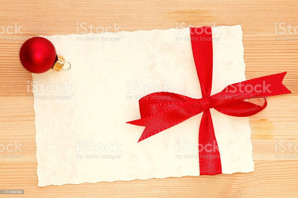 parchment card with space for text and red bow royalty-free stock photo