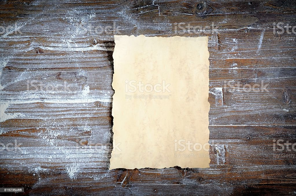 Parchment on wooden table covered with flour stock photo