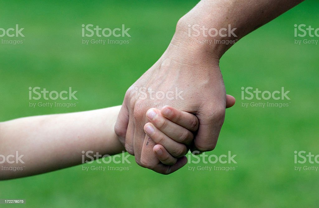 Parent and child holding hands royalty-free stock photo