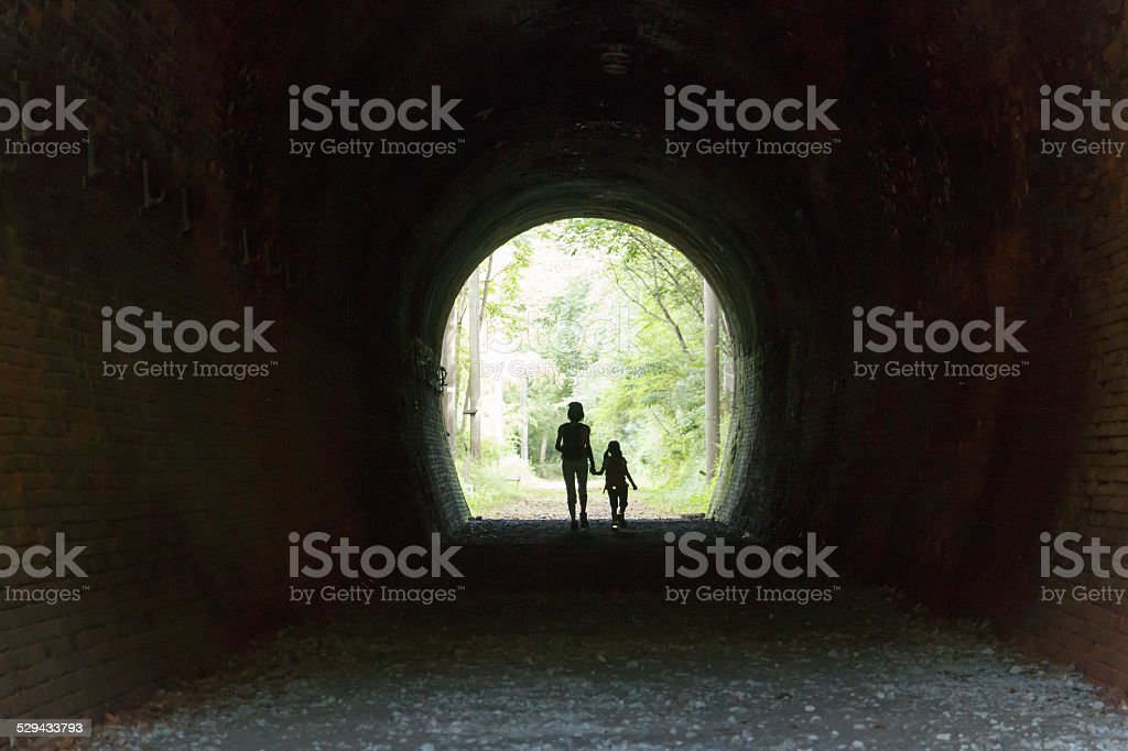 Parent and child who walk the tunnel stock photo