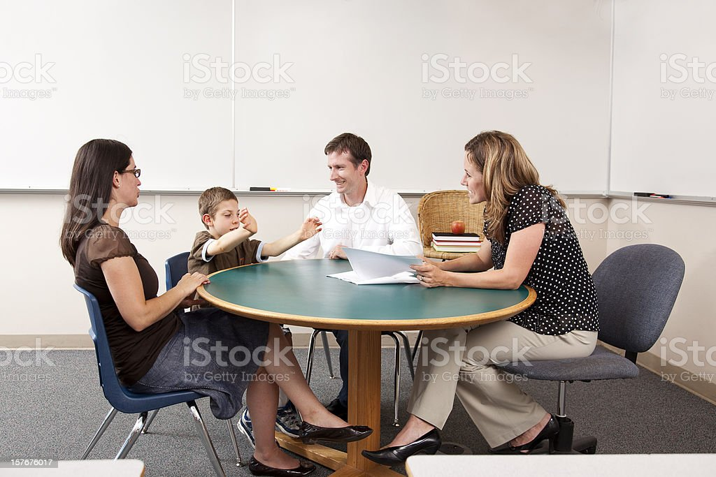 Parent and Teacher Conference in a Classroom royalty-free stock photo