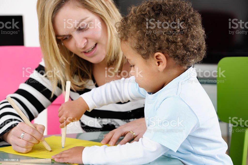 Parent Enjoying Drawing With Toddler stock photo