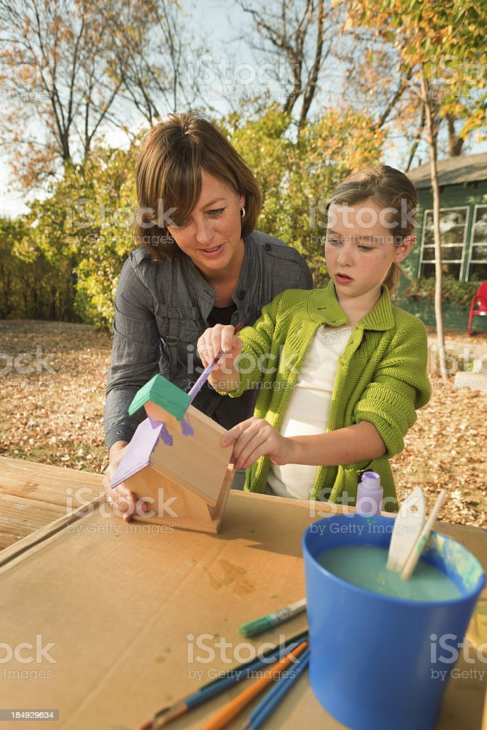 Parent Helping Children in Birhouse Painting Project Vt royalty-free stock photo