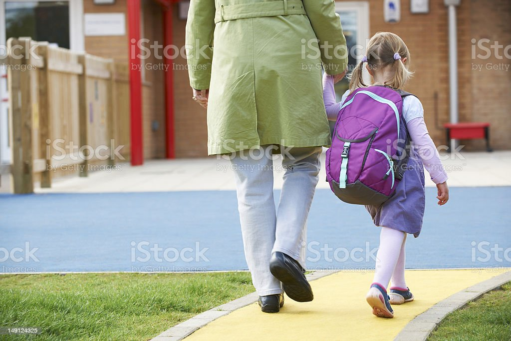 Parent Taking Child To Pre School stock photo