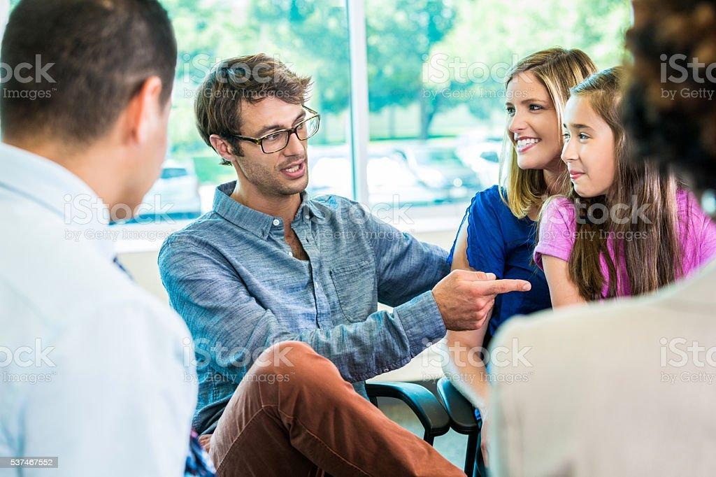 Parent teacher meeting with family stock photo
