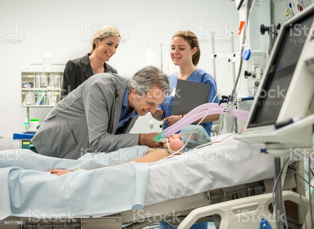 Parent Visit Daughter In Hospital stock photo