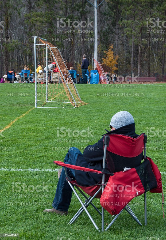 Parent Watches Youth Soccer stock photo