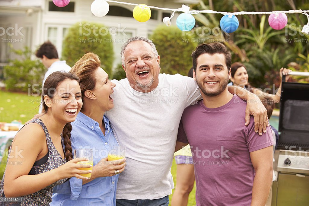 Parent With Adult Children Enjoying Party In Garden stock photo