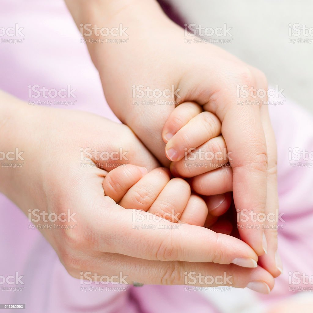 Parental love and support with heart shaped hands closeup stock photo