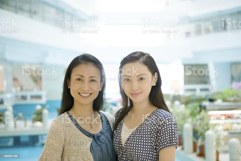 Parents and child nestling up with smile royalty-free stock photo