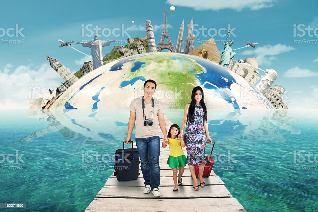 Parents and child on trip to the world monument stock photo