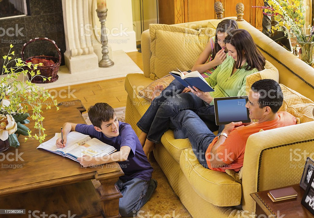 Parents And Children In Sitting Area royalty-free stock photo