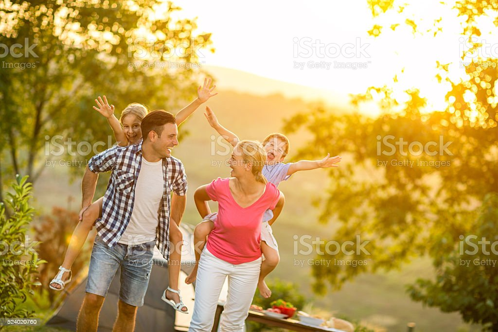 parents and children on vacation playing together stock photo