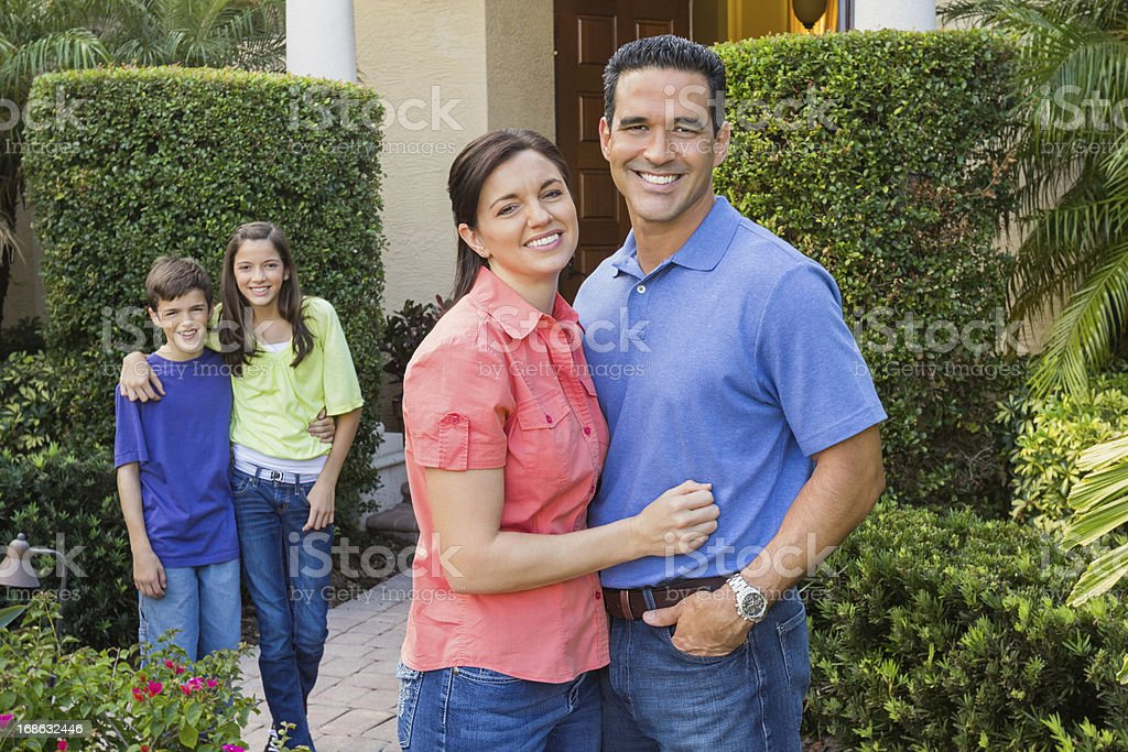 Parents And children Standing In Lawn royalty-free stock photo