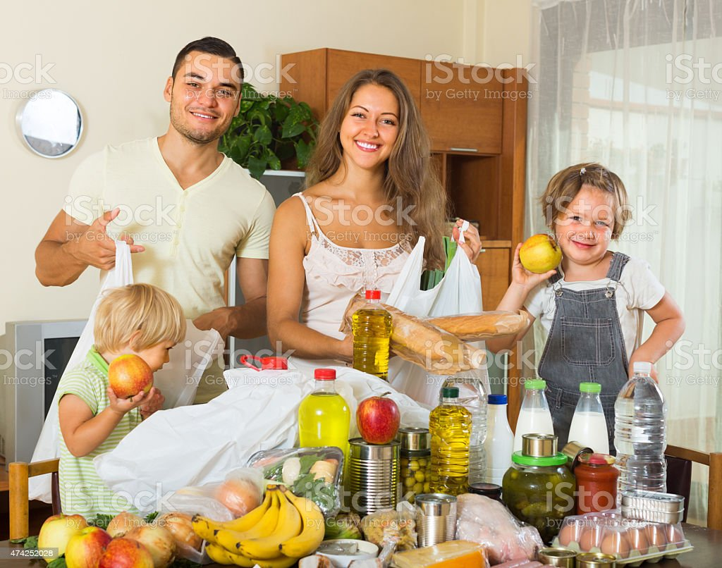 Parents and children with food stock photo
