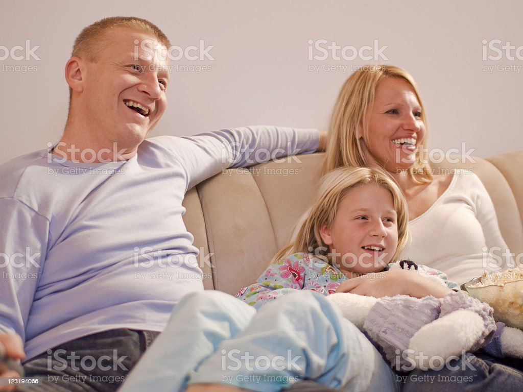 Parents and Daughter Watching TV royalty-free stock photo