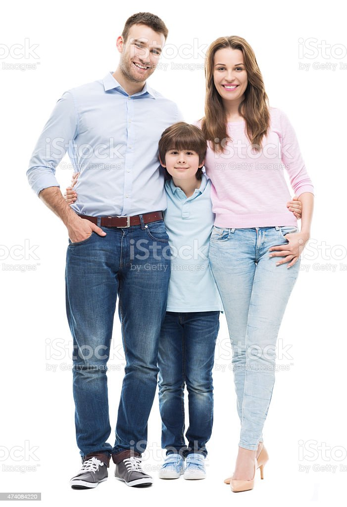 Parents and their son pose happily stock photo