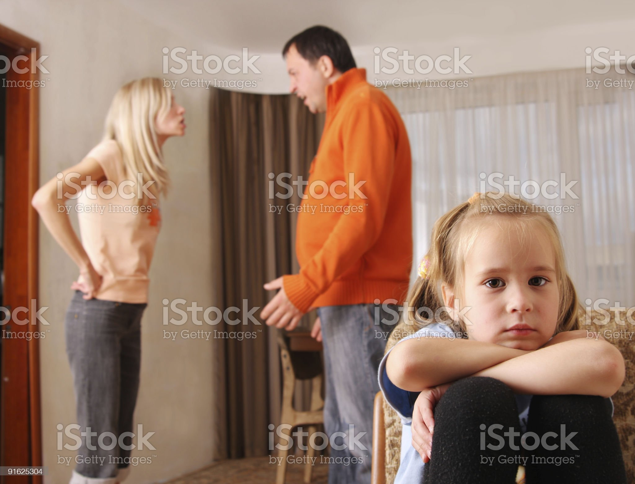Parents arguing while child suffers royalty-free stock photo