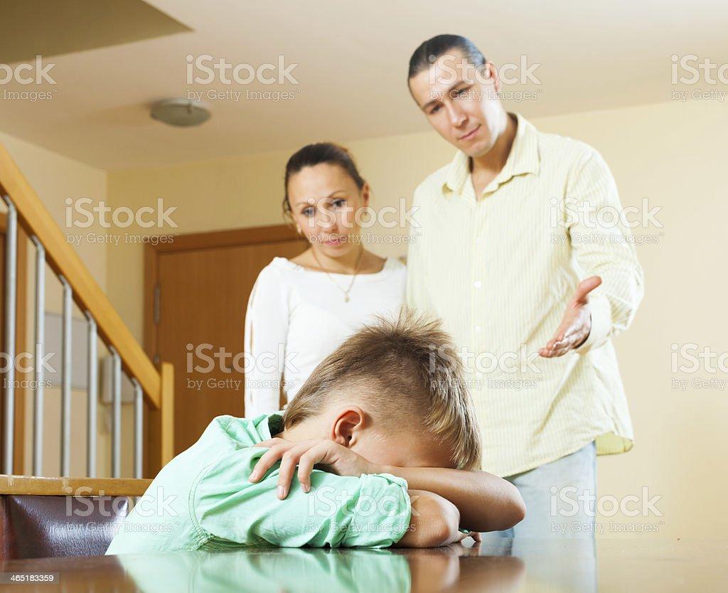 Parents berating teenager son stock photo