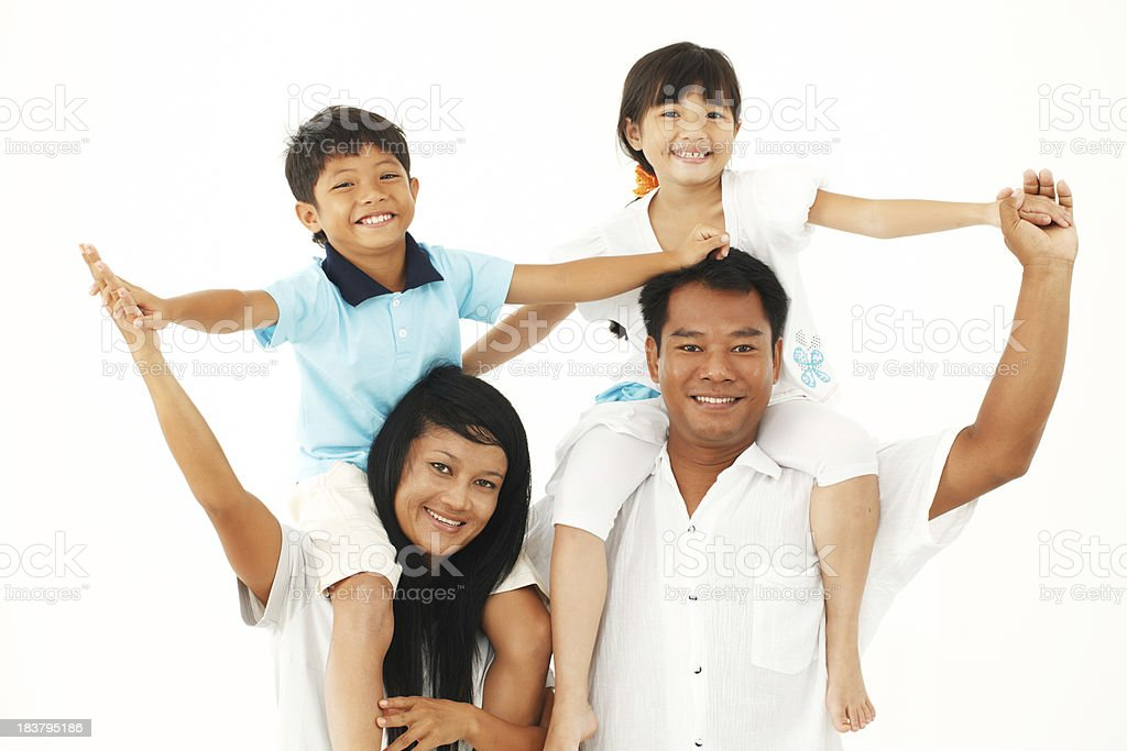 Parents carrying their children on shoulders. royalty-free stock photo