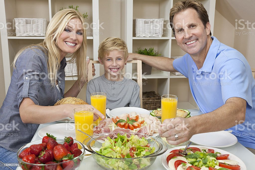 Parents Child Family Healthy Food & Salad At Dining Table royalty-free stock photo