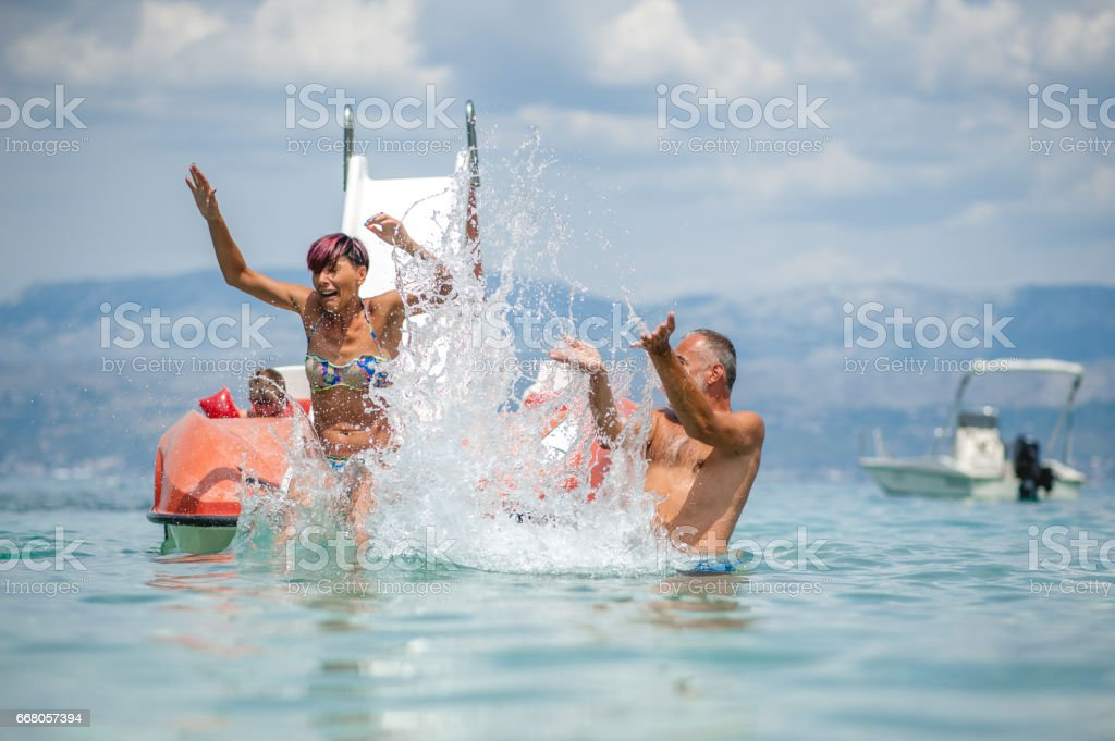 Parents Enjoying With Children On Pedalo Boat stock photo