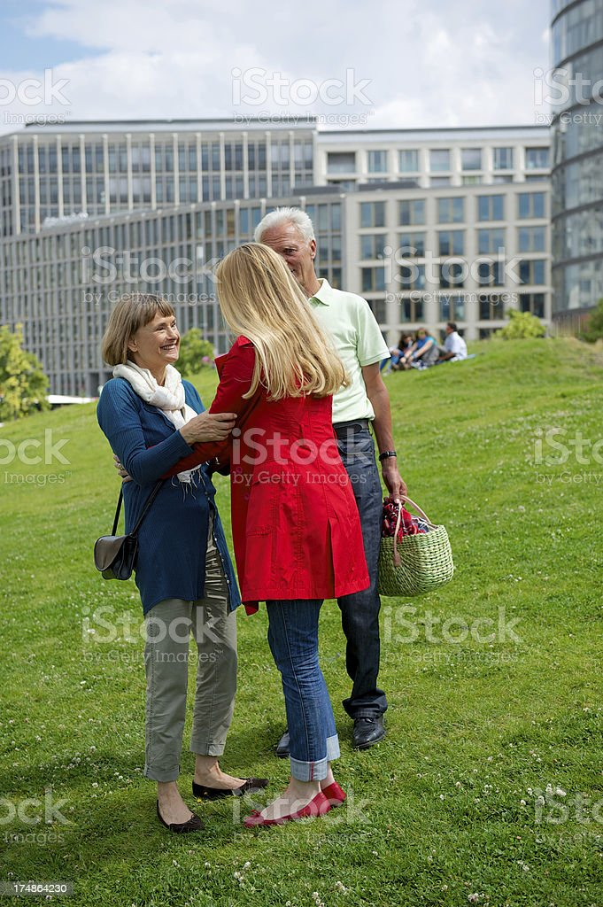 Parents greeting daughter royalty-free stock photo