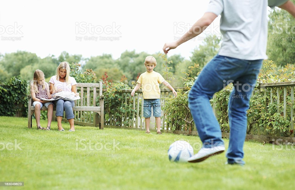 Parents having a good time with their kids in park royalty-free stock photo