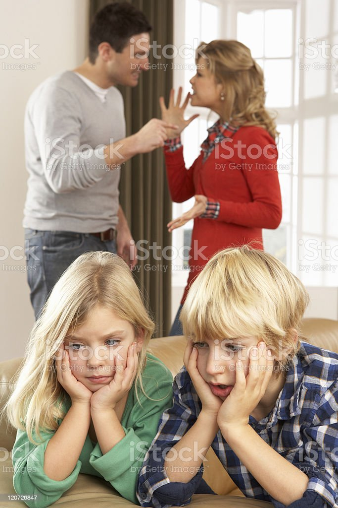 Parents Having Argument At Home In Front Of Children royalty-free stock photo