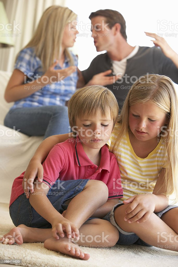 Parents Having Argument In Front Of Children royalty-free stock photo