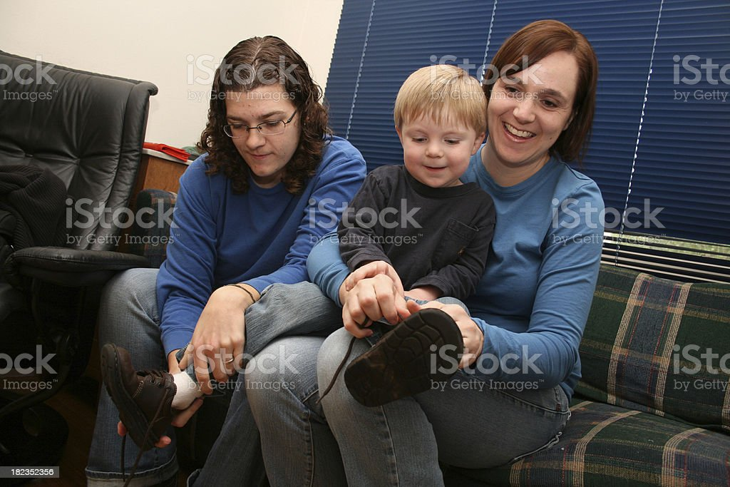Parents Helping Toddler Put on Shoes royalty-free stock photo