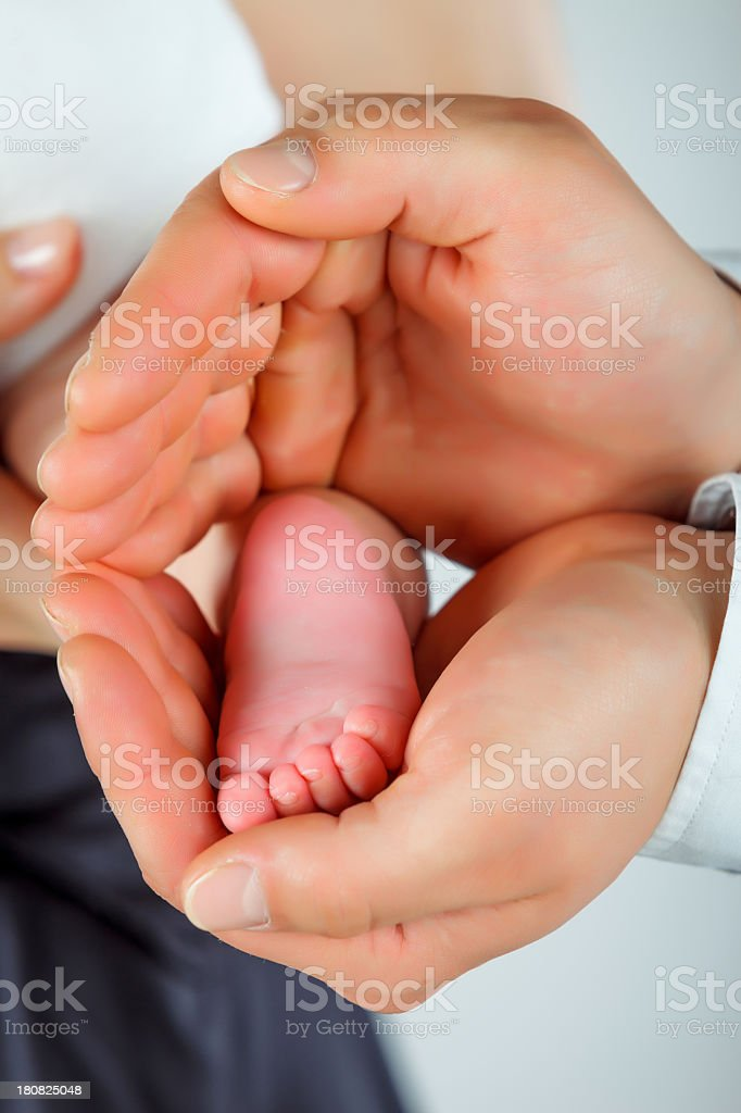 Parents holding baby's feet royalty-free stock photo