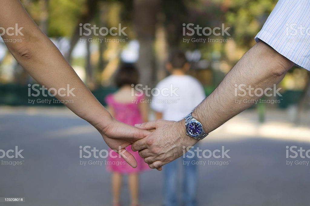 Parents Holding Hands with Kids in Front royalty-free stock photo