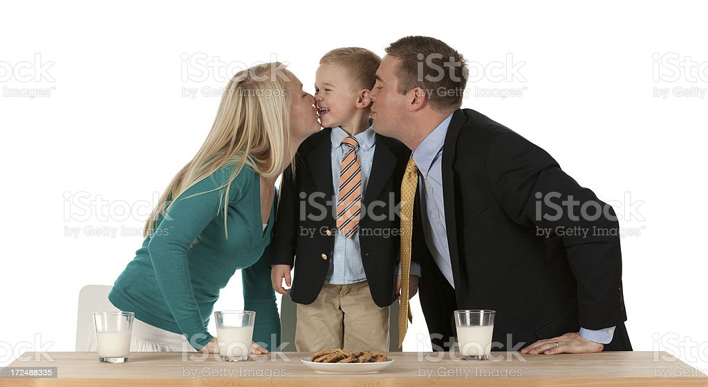 Parents kissing their son royalty-free stock photo