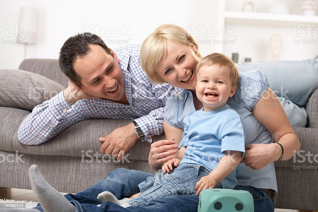 Parents laughing with baby royalty-free stock photo