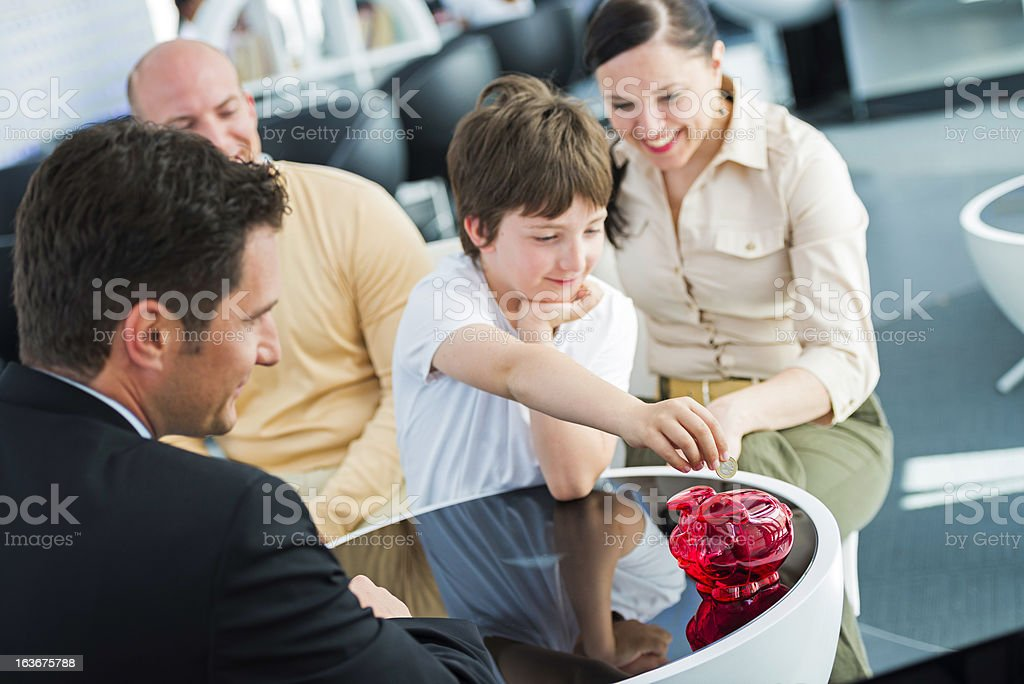 Parents Opening Bank Account For Their Child royalty-free stock photo
