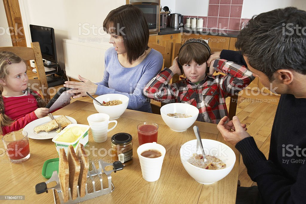 Parents Taking Away Gadgets From Children Whilst Eating Breakfast stock photo