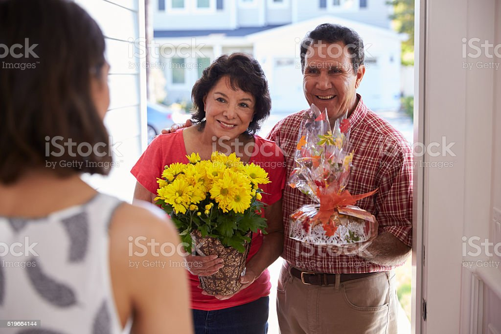 Parents Visiting Hispanic Daughter In New Home stock photo