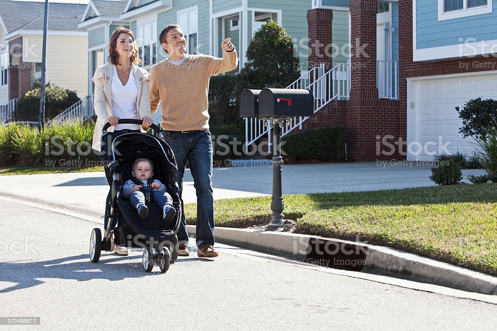 Parents walking with baby royalty-free stock photo