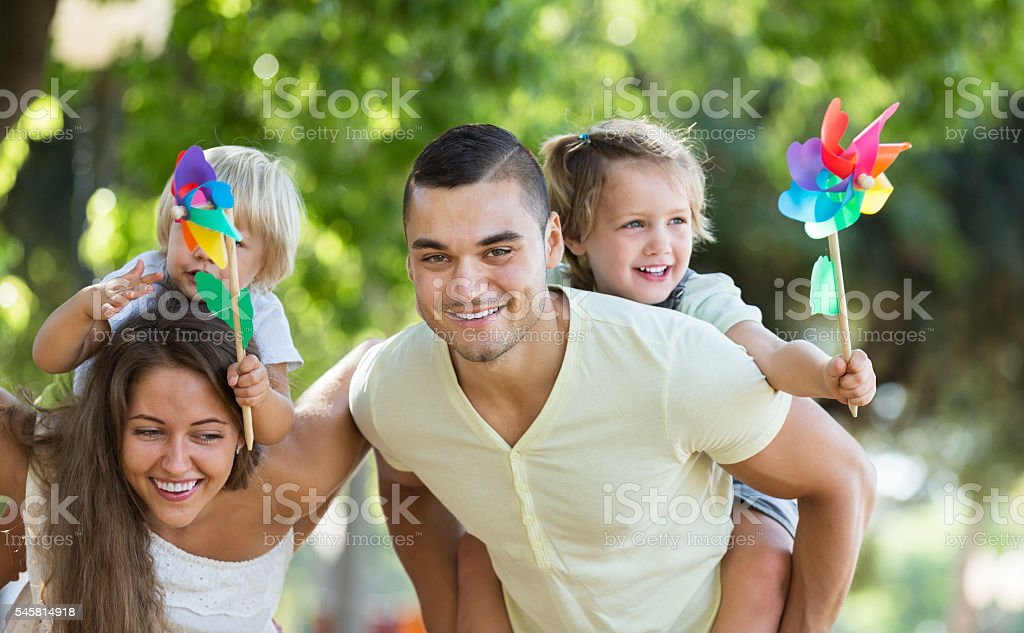 Parents walking with children stock photo