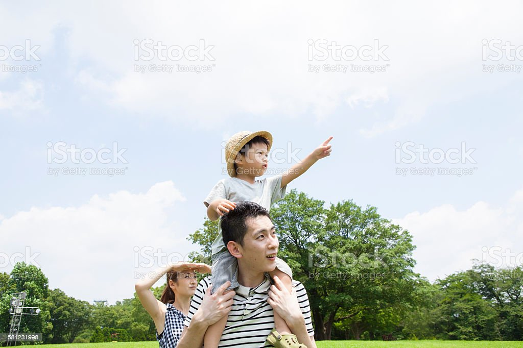 Parents who have seen direction in which child is pointing stock photo