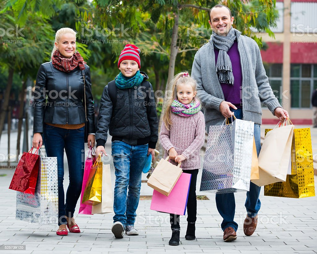 Parents with children shopping in city stock photo