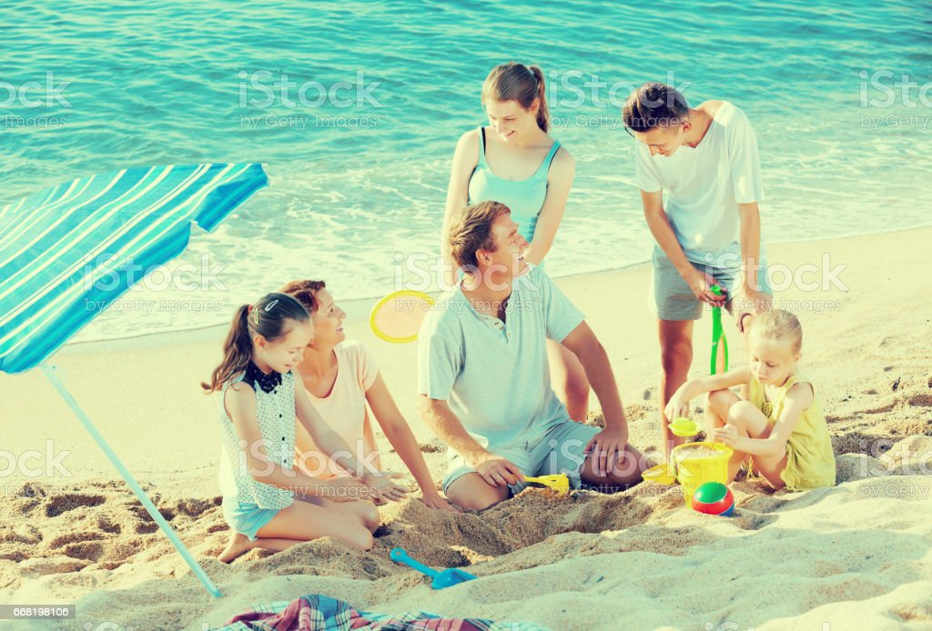 Parents with four children playing stock photo