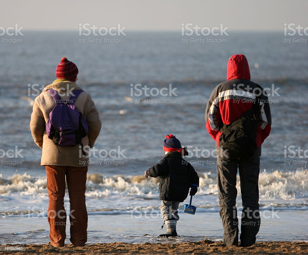 parents with kid stock photo